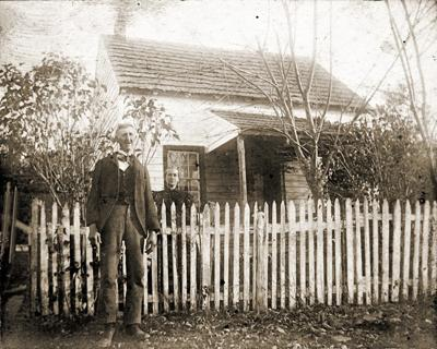 Out of Past couple in front of picket fence
