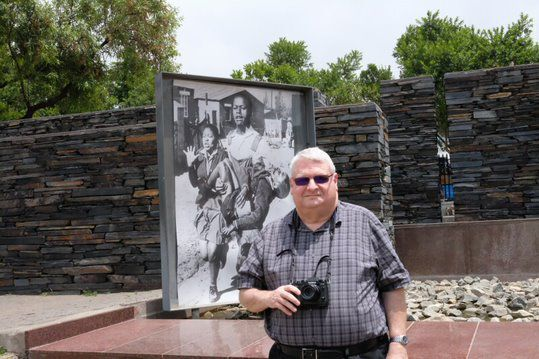 George Stone in front of apartheid