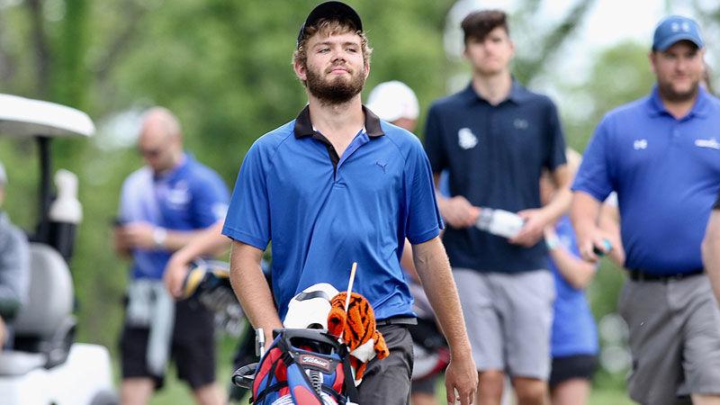 2019 WIAA state boys golf tournament | Merrill's Russell Dettmering walking to tee box