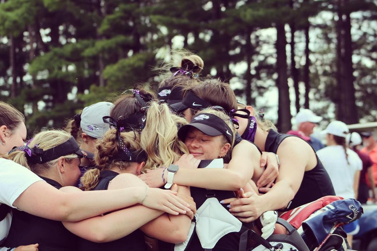 Kelly Stori celebrates with teammates