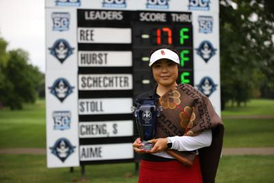 Robynn Ree with trophy at leaderboard.JPG