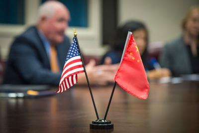 U.S. China flags and Perdue
