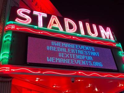 Stadium goes red in alert for survival of performance centers