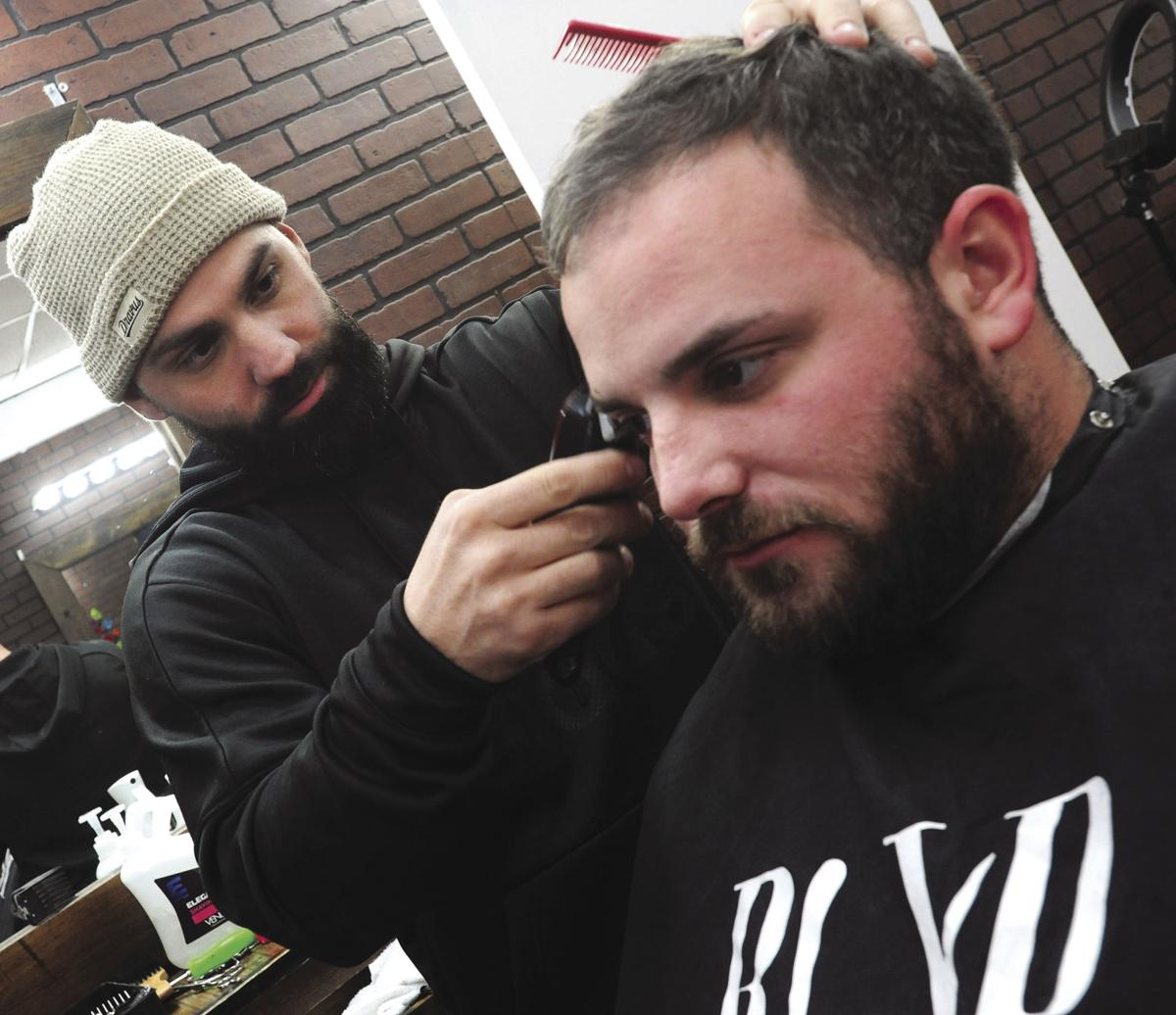 A CUT ABOVE: Thanks to local barber, Woonsocket High's football team received Super Bowl sendoff from Patriots rookie running back Sony Michel