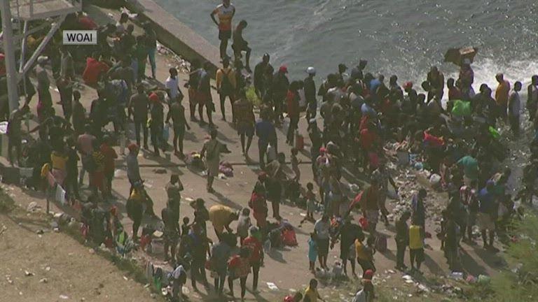 migrants under bridge2.jpg