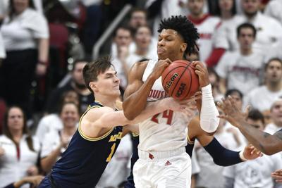 No. 1 Louisville tops No. 4 Michigan 58-43 in Big Ten/ACC
