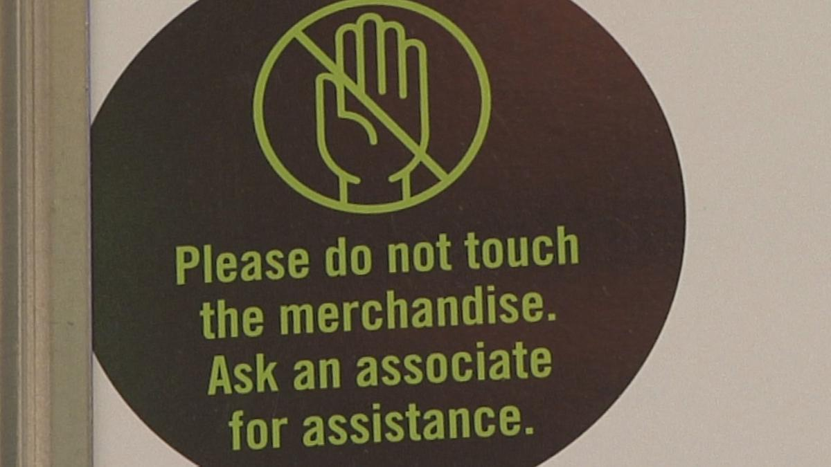 "Jourrneys ""Please do not touch the merchandise"" sign"