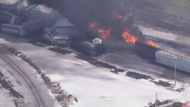 Homes, schools being evacuated after train derailment, fire