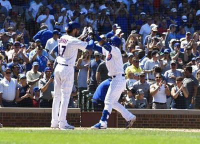 Báez, Cubs come out swinging, beat Brewers 6-2