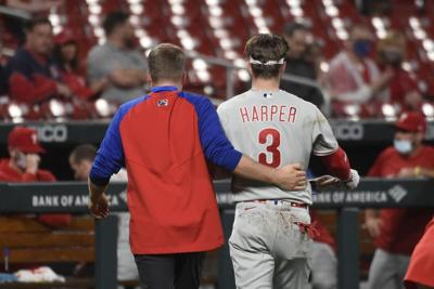 Phillies' Bryce Harper hit by pitch in face, walks off