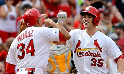 Thomas' slam leads Cardinals to comeback win over Pirates