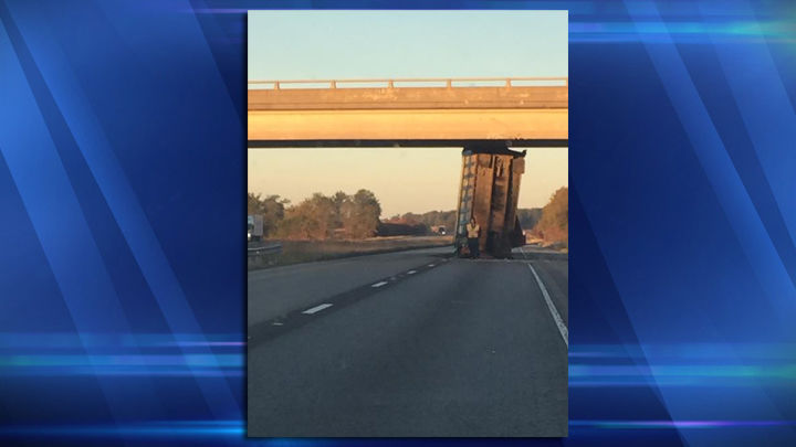 Dump truck wedged under overpass in Wayne County, IL