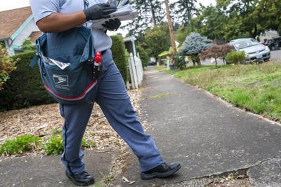 201009-usps-postal-worker-mn-1230_633f1f76bfc42244b94ea50e3d848ae4.fit-2000w.jpg