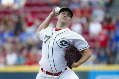 Trevor Bauer fans 11 in Reds home debut, beats Cubs 5-2