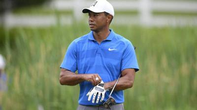 Woods has surgery on left knee for minor cartilage damage