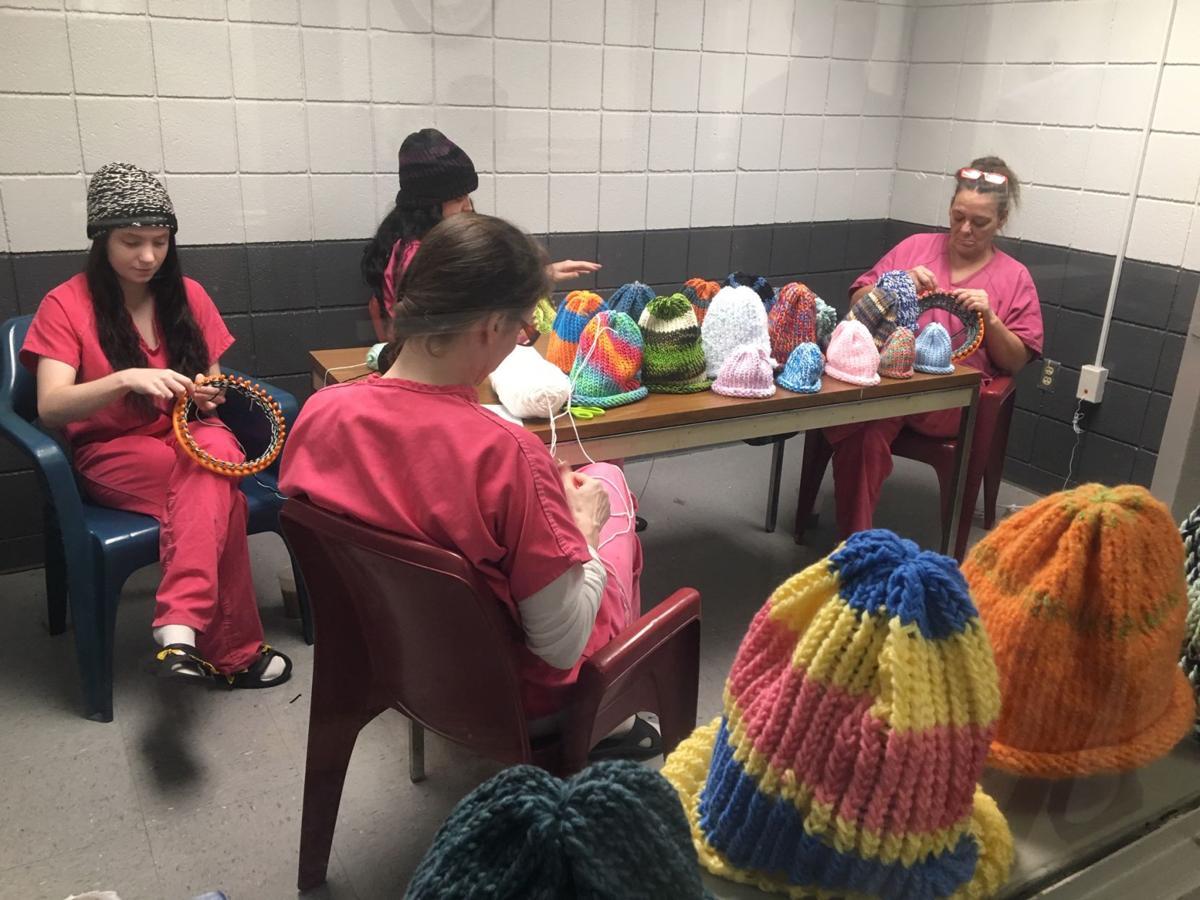 inmates making hats.JPG