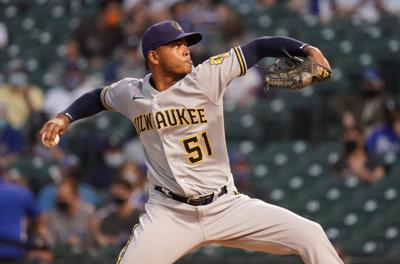 Peralta pitches 5 innings as Brewers blank Cubs 4-0