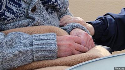nursing home holding hands elderly generic