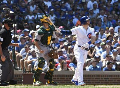Happ's slam leads Quintana, Cubs over Athletics 10-1