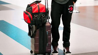 man with luggage travel.jpg