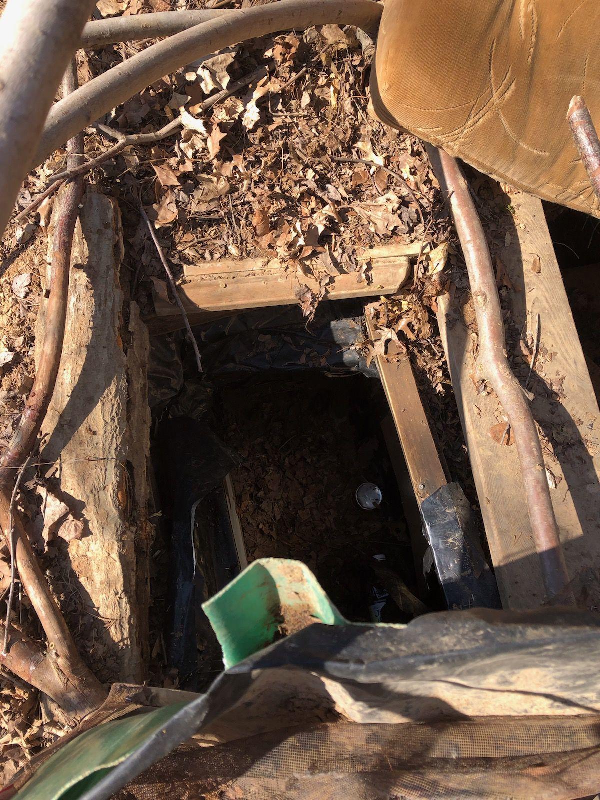 Fugitive found in underground bunker