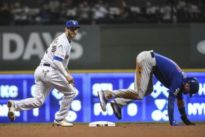 Brewers beat up Lester, top Cubs 8-5 to narrow WC lead