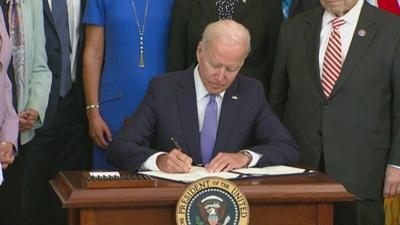 biden signs crime victims funding bill.jpg