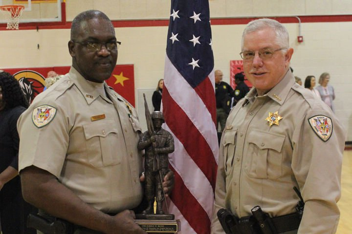 Army National Guard Command Sgt. Harold Banks and Sheriff Karl Jackson