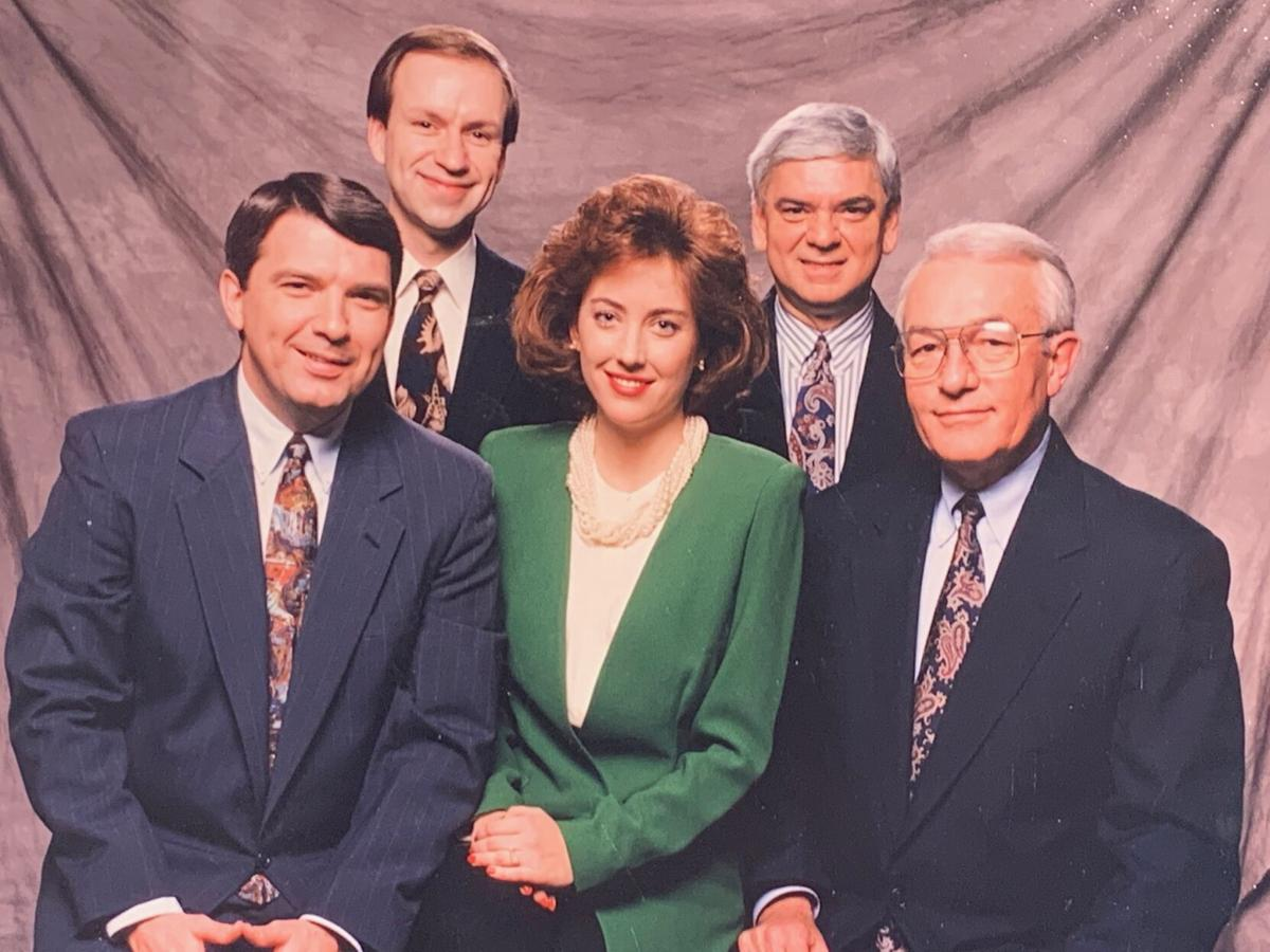 Larry McIntosh, seen in the right rear of this photo, poses with fellow members of the Local 6 news team in the mid-1980s.