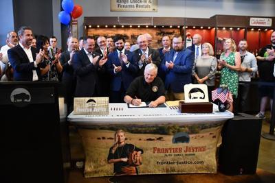 Gov. Mike Parson signs second amendment bill