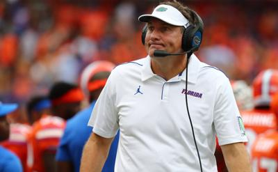 Florida's Mullen joins players in testing positive for virus