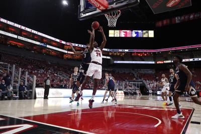 Jones, Withers lead Louisville past Notre Dame 69-57