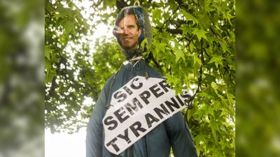 Andy Beshear effigy hung