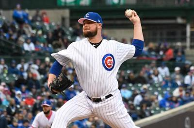 Lester pounded as Garneau, Piscotty HR, A's rout Cubs 11-4