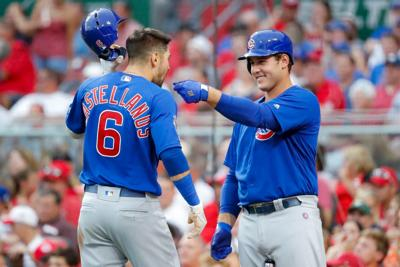Rizzo celebrates, Cubs beat Reds 12-5 for biggest lead