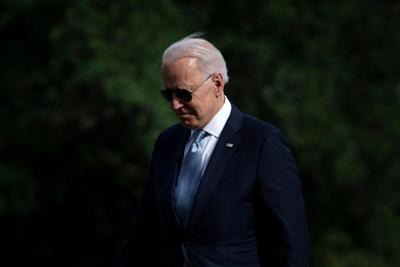 **This image is for use with this specific article only** US President Joe Biden walks from