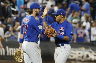 Darvish, Baez lead Cubs past Mets 5-2 in series opener