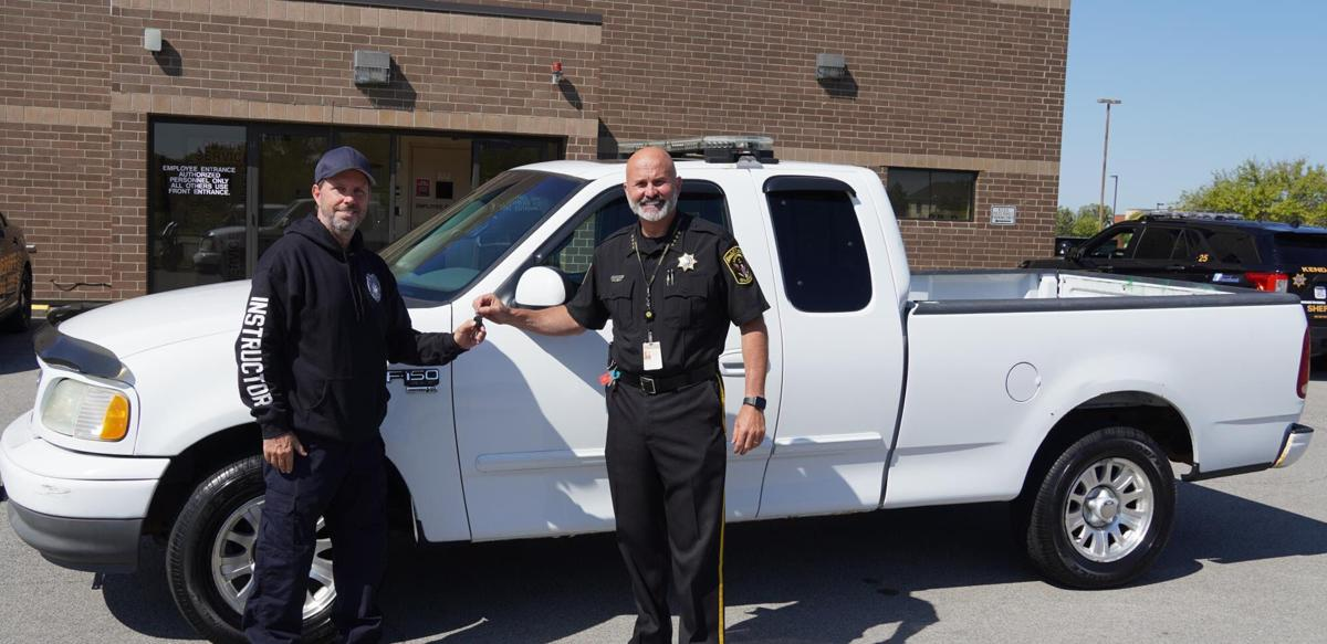 Sheriff Baird handing the keys to Vince Logan from Indian Valley Vocational Center.jpg
