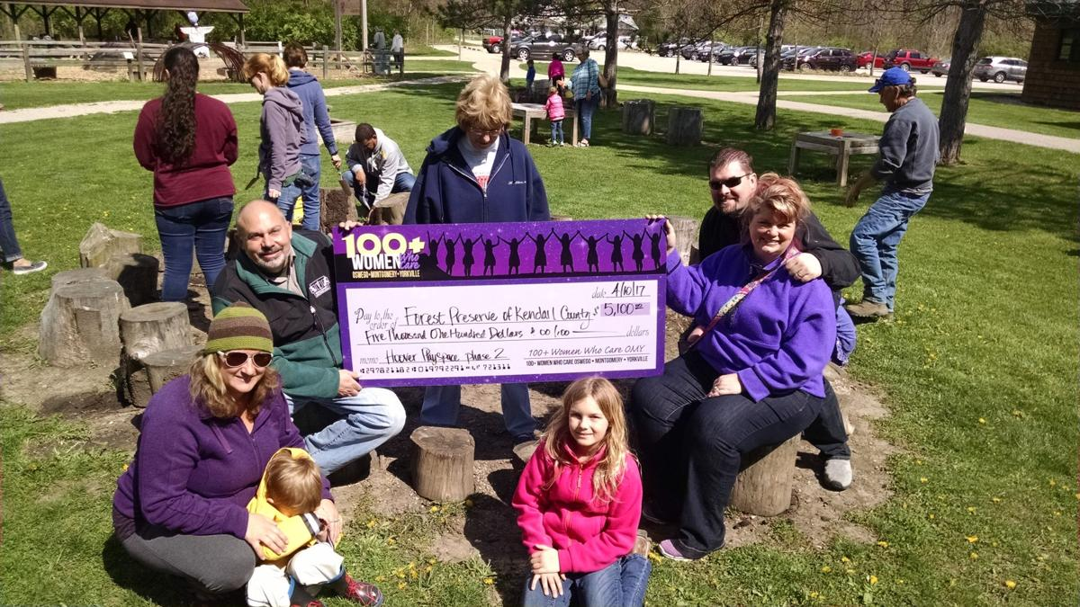 Illinois kendall county oswego - Kendall County Forest Preserve Director David Guritz Holding The Check Left Accepts A 5 100 Donation From 100 Women Who Care Oswego Montgomery