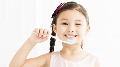 Too much toothpaste may hurt your child's smile, study says