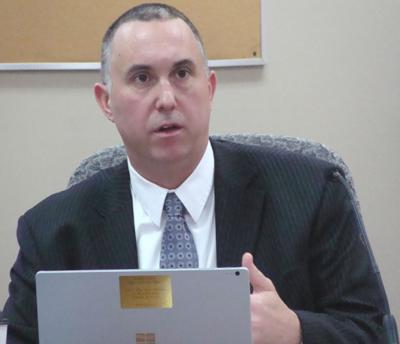 Kendall County State's Attorney Eric Weis at a Kendall County Board Meeting.