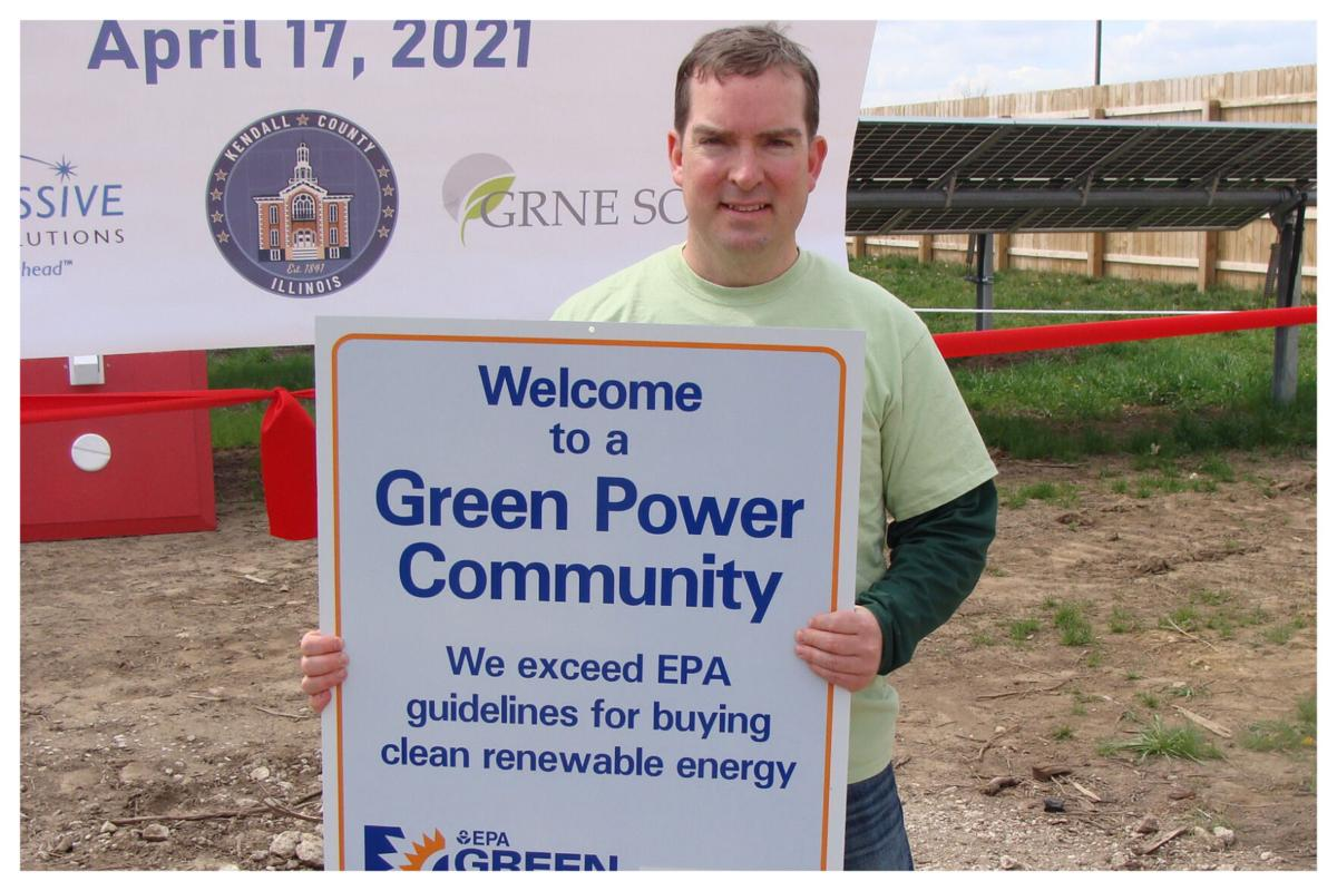 Scott Gryder with Green Power Community Sign