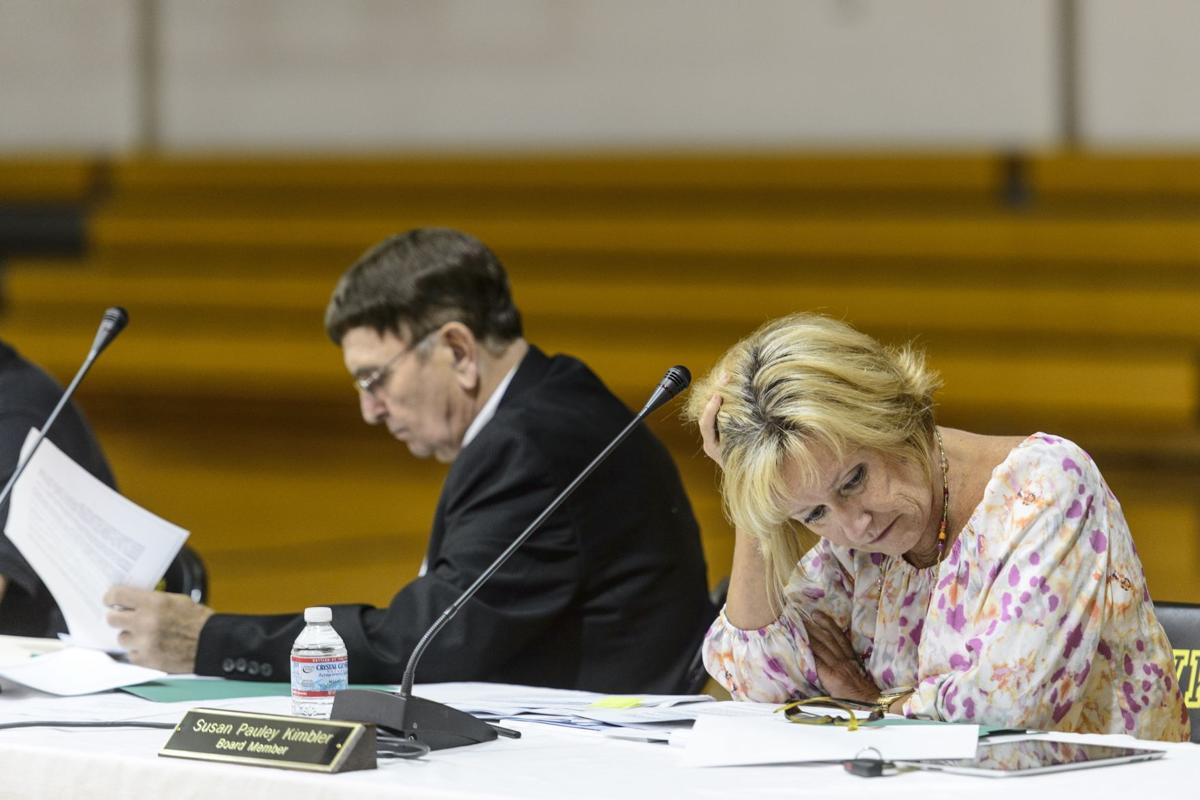 Boone makes school cuts, averts takeover by WVBOE