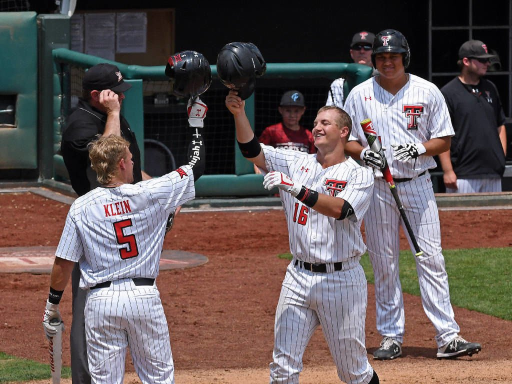 19e83e30aa0 Texas Tech s Brian Klein (5) celebrates with teammate Josh Jung after  Jung s two-run home run in the fifth inning Saturday afternoon against WVU.