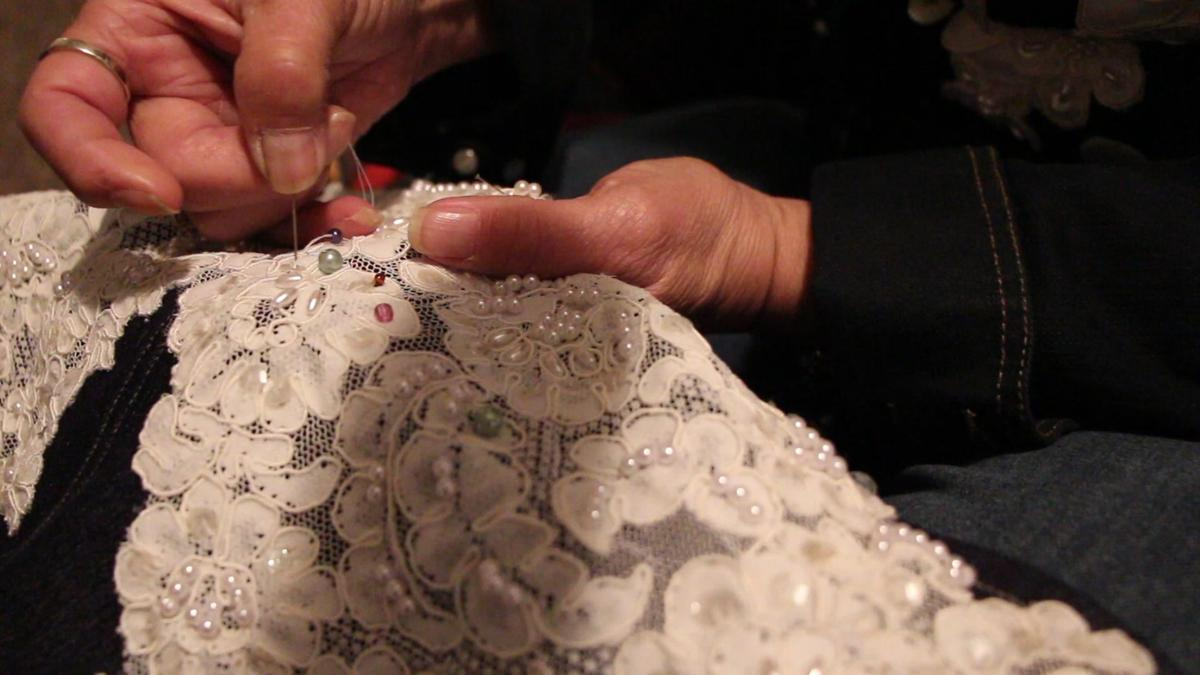 Seamstress weds denim and lace on clothes