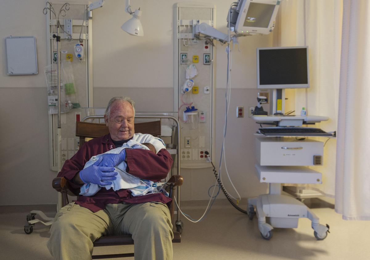 BABY ROCKER - Bud Sears rocks a baby