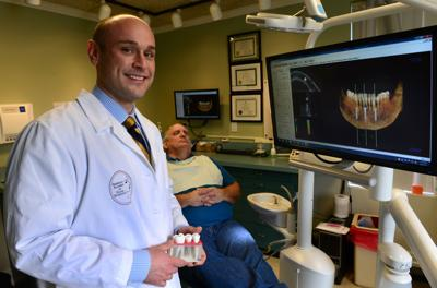 Local dentist recognized for work in implants
