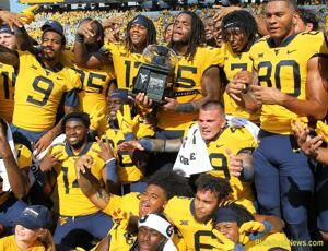 WVU holds on for win over Virginia Tech