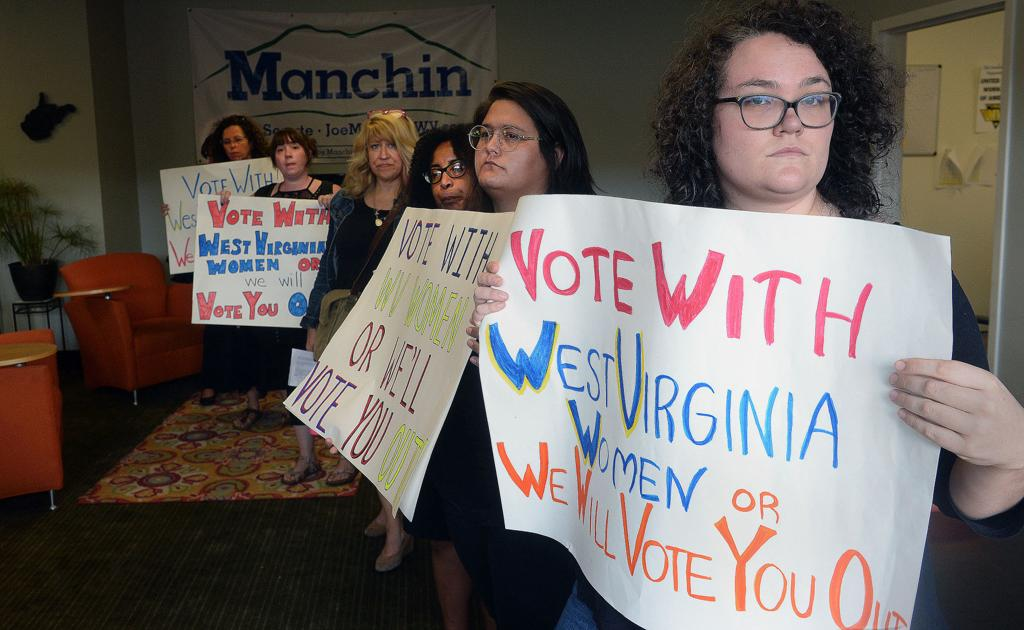 Nine charged with trespassing at Manchin's office after