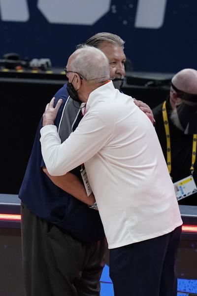 hugs from Syracuse West Virginia Basketball